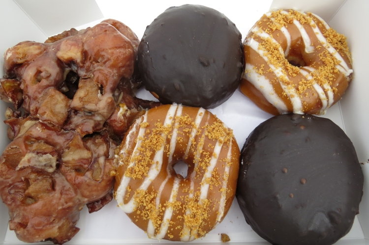 Apple fritters, pumpkin delight, Burlington cream doughnuts